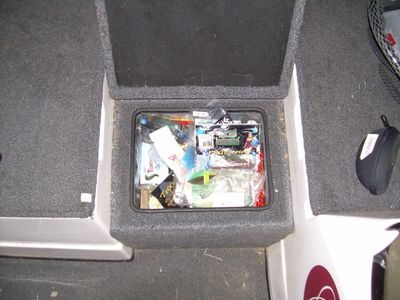 Cluttered bass boat compartment