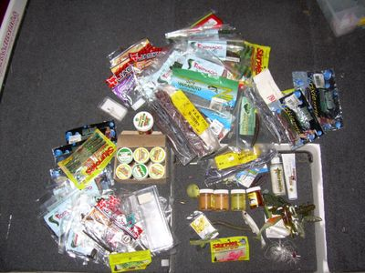 Contents of bass boat tackle compartment